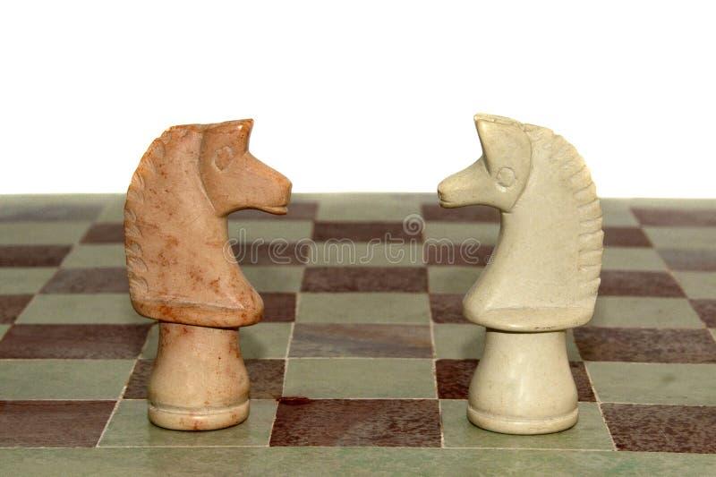konia szachowy marmur dwa zdjęcia royalty free