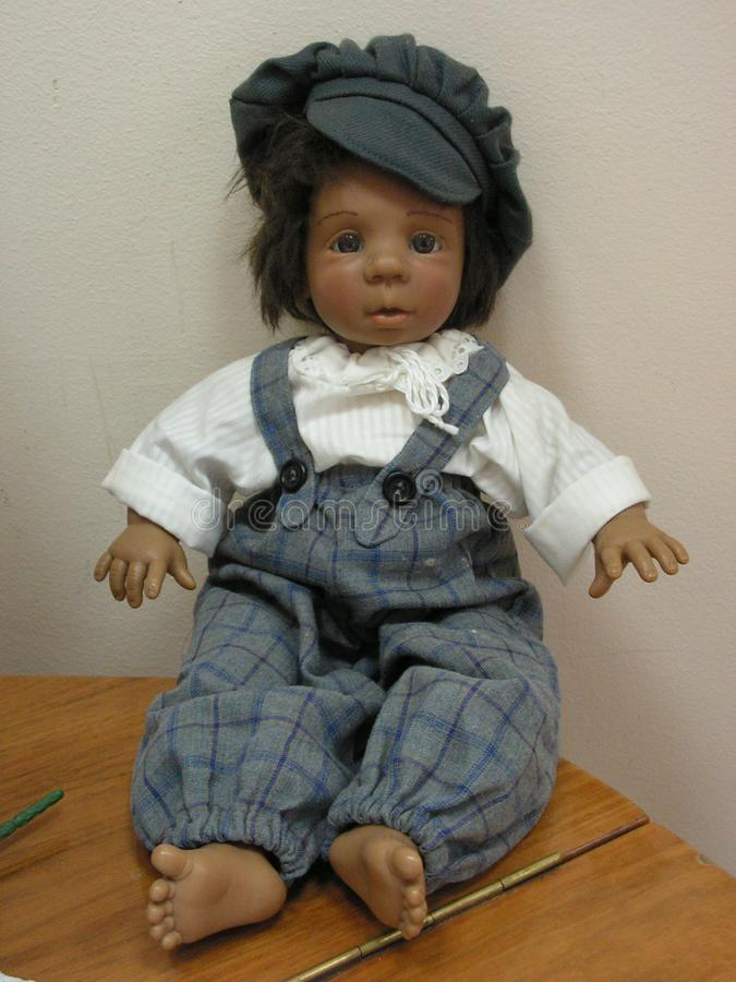 The doll is a children`s toy. A doll is a children`s toy stock photo