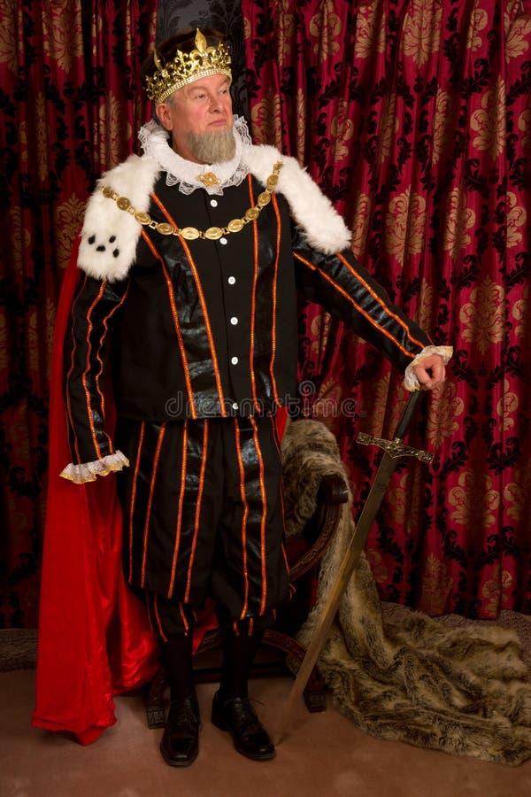 Koning met zwaard stock foto