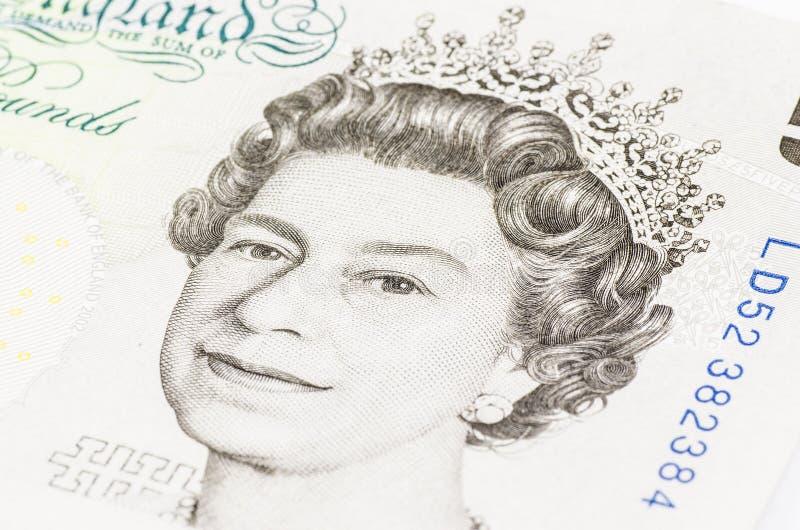 Koningin elizabeth in een 5 pond stock afbeeldingen