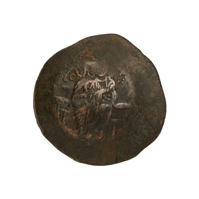 Konkavt forntida koppar- eller bronsbyzantinemynt som isoleras på vit royaltyfria bilder