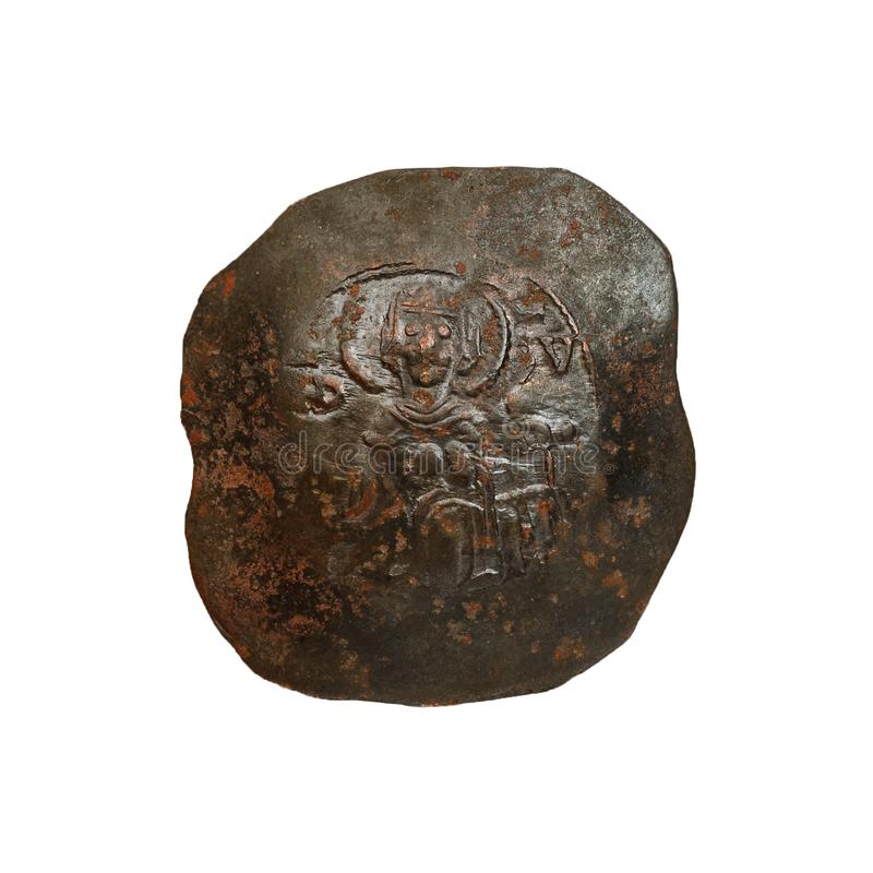 Konkavt forntida koppar- eller bronsbyzantinemynt som isoleras p? vit royaltyfri foto