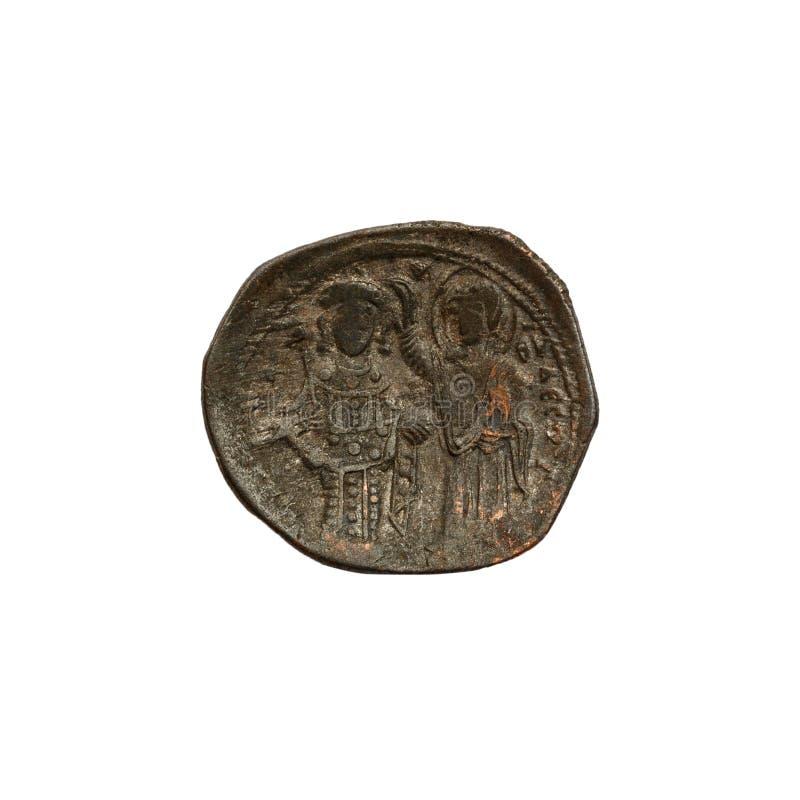 Konkavt forntida koppar- eller bronsbyzantinemynt som isoleras p? vit royaltyfria foton