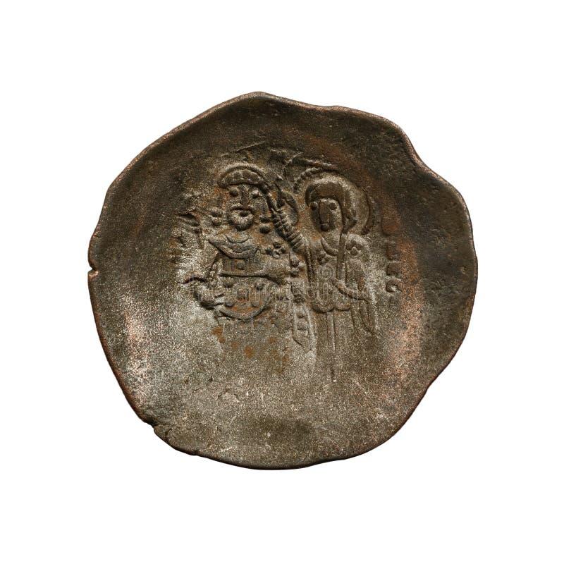 Konkavt forntida koppar- eller bronsbyzantinemynt som isoleras p? vit arkivfoton