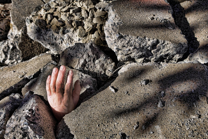 konkret död jordskalvhandman ut s fotografering för bildbyråer