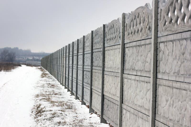 konkretny płot Zima zdjęcie stock