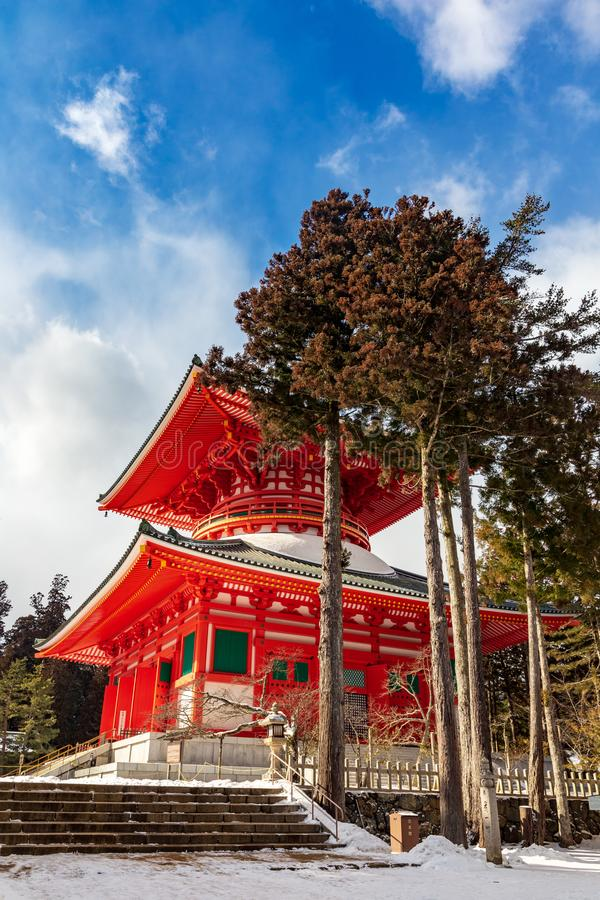Konpon Daito red pagoda, Danjo Garan, Koyasan, covered with snow on a sunny day, UNESCO World Heritage area, Japa. Konpon Daito red pagoda in Danjo Garan complex stock image