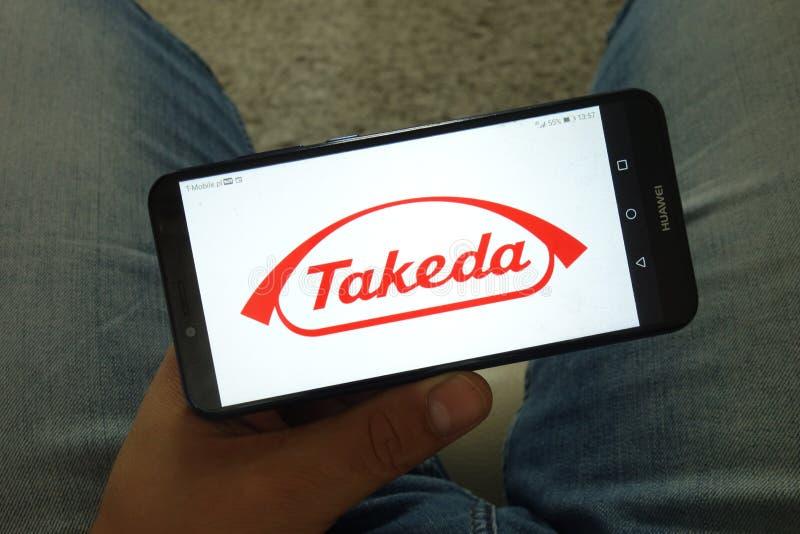 KONSKIE, ПОЛЬША - 29-ое июня 2019: Логотип фармацевтическую компанию Ltd Takeda на мобильном телефоне стоковое фото rf