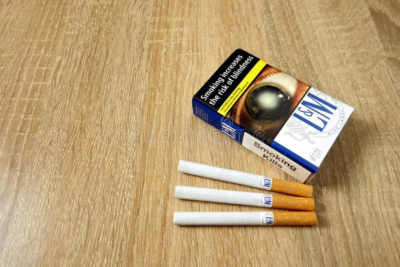 KONSKIE, POLAND - June 21, 2019: Blue LM pack of cigarettes on wooden table royalty free stock images