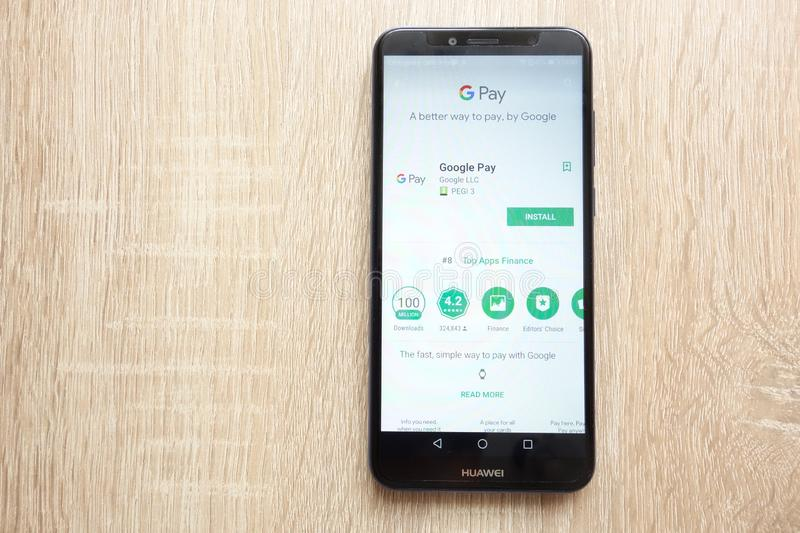 Google Pay app on Google Play Store website displayed on Huawei Y6 2018 smartphone. KONSKIE, POLAND - JUNE 17, 2018: Google Pay app on Google Play Store website royalty free stock photos