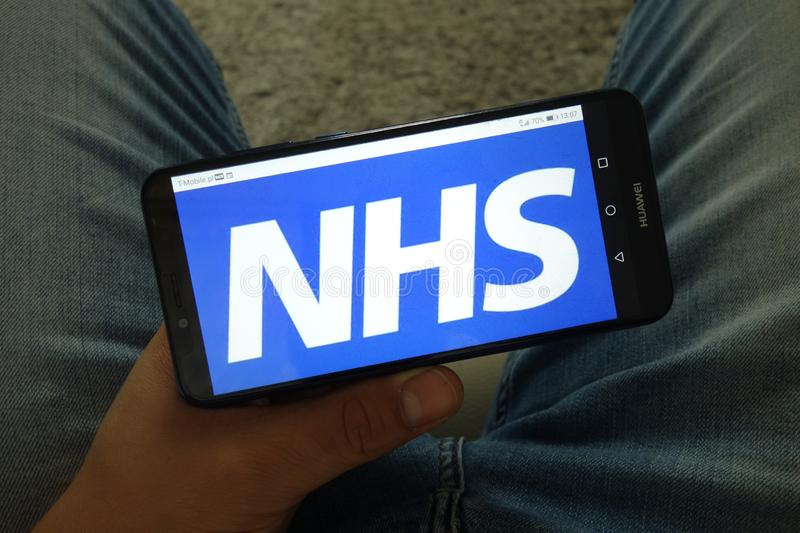 KONSKIE, POLAND - June 29, 2019: National Health Service - NHS logo on mobile phone royalty free stock photo