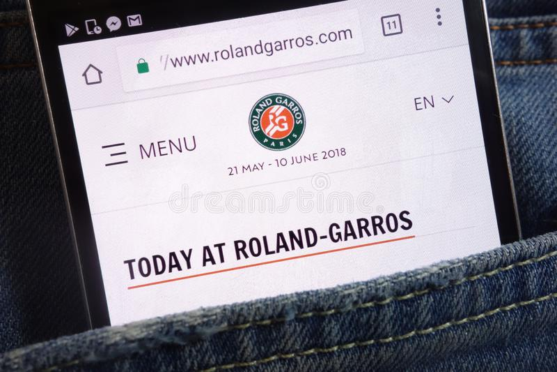 Roland Garros website displayed on smartphone hidden in jeans pocket stock photo