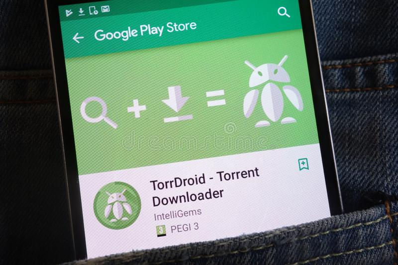 TorrDroid app on Google Play Store website displayed on smartphone hidden in jeans pocket. KONSKIE, POLAND - JUNE 02, 2018: TorrDroid app on Google Play Store royalty free stock photo