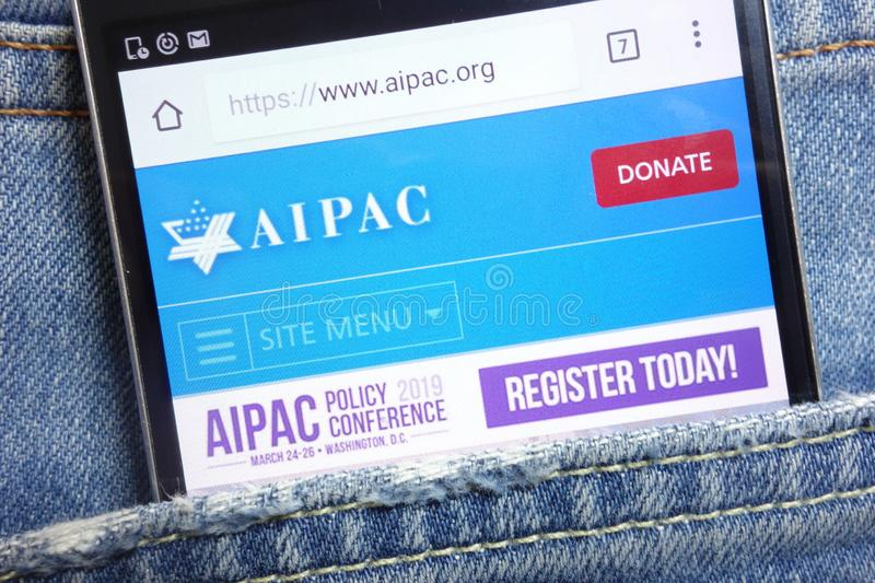 AIPAC website displayed on smartphone hidden in jeans pocket. KONSKIE, POLAND - MAY 18, 2018: AIPAC website displayed on smartphone hidden in jeans pocket royalty free stock photography