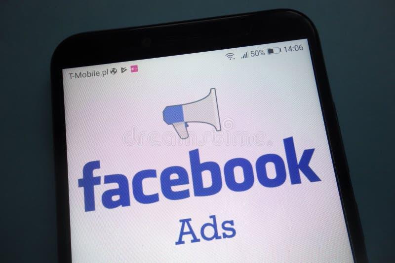 Facebook Ads logo on smartphone. KONSKIE, POLAND - OCTOBER 28, 2018: Facebook Ads logo on smartphone stock photography