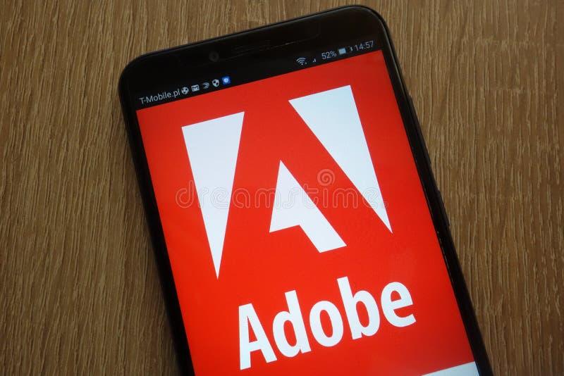 Adobe logo displayed on a modern smartphone stock image