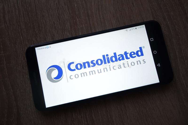 Konsolidujący Teletechniczni mienia, Inc logo wystawiaj?cy na smartphone zdjęcia stock