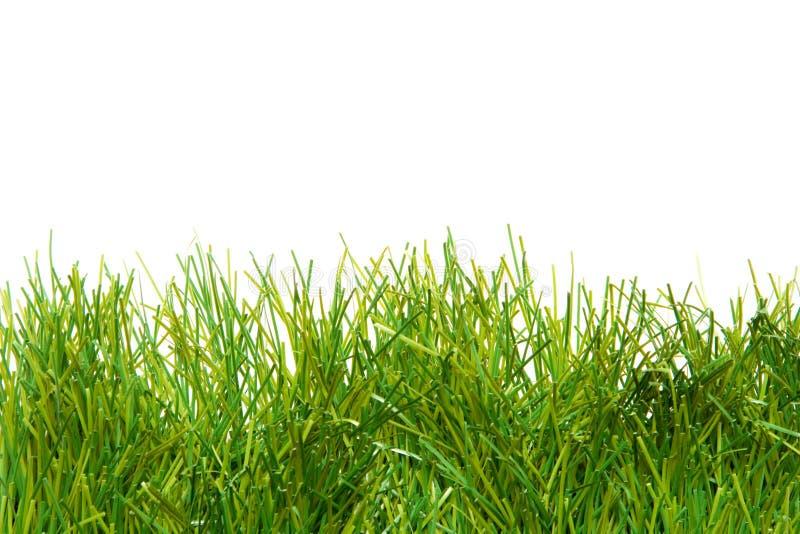 konstgjord frodig gräsgreen arkivbild