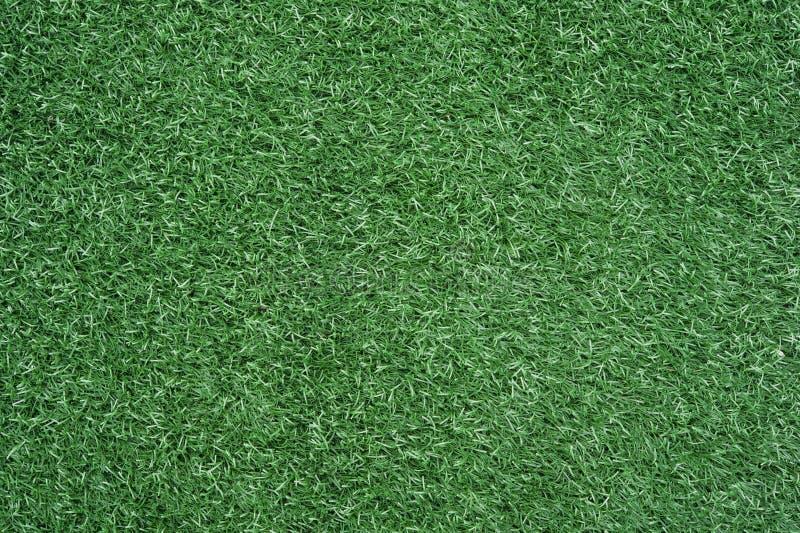 Konstgjord gräsbakgrund för fotboll royaltyfri foto