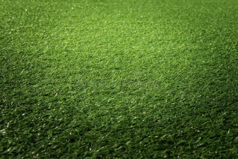 Konstgjord texturbakgrund för grönt gräs arkivbilder
