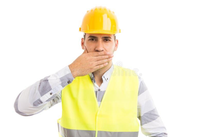 Konstruktör eller byggmästare som täcker hans mun royaltyfri fotografi
