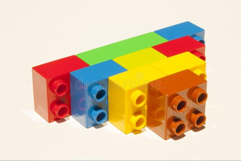 Konstruktion för Lego byggnadskvarter royaltyfria bilder