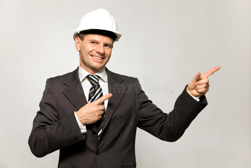 konstruktion som pekar arbetaren fotografering för bildbyråer