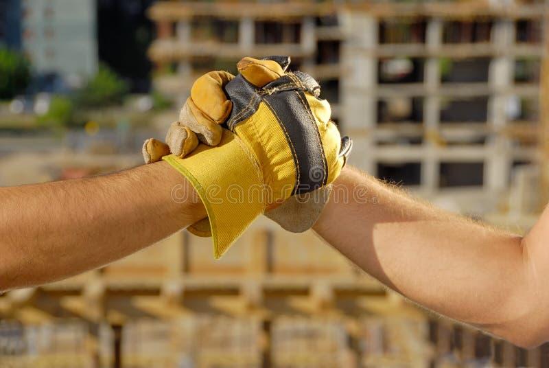 konstruktionsavtalshandskakning arkivbild