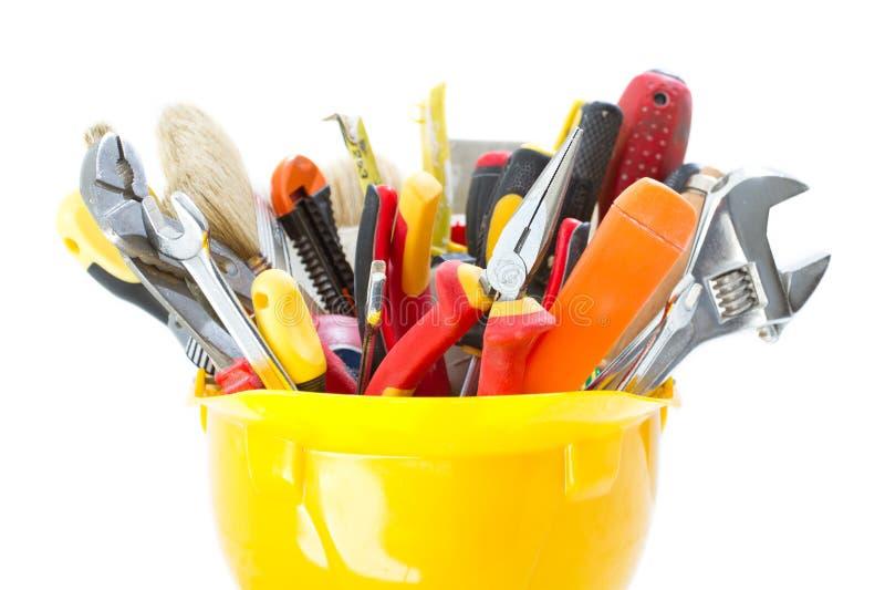 Konstruktionshjälpmedel i toolboxen för hård hatt, maskinvarurenovering, teknisk service royaltyfri foto