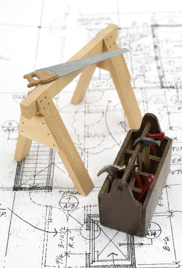 konstruktionshuset planerar hjälpmedel royaltyfri foto
