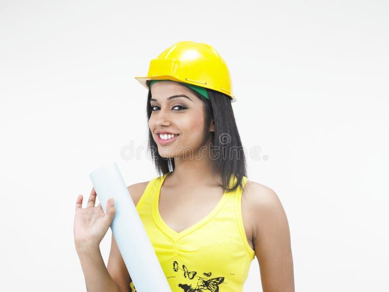 konstruktionskvinnligarbetare royaltyfri bild