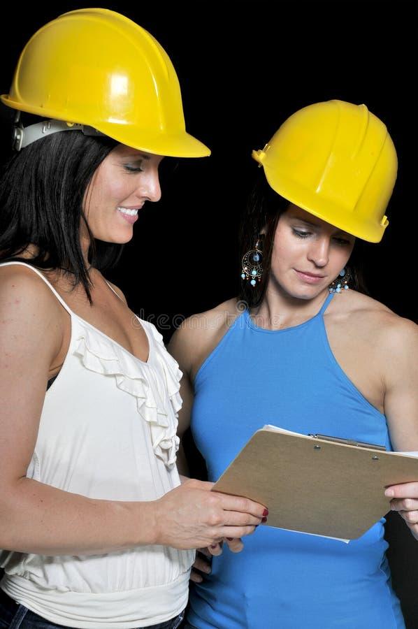 konstruktionskvinnligarbetsledarear arkivfoton