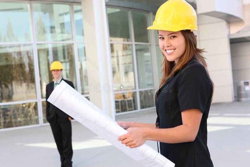 konstruktionsmankvinna royaltyfria bilder