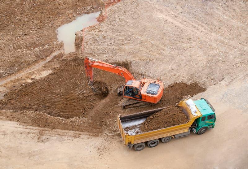 Konstruktionsplats och grävskopa royaltyfri fotografi