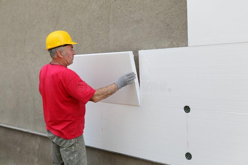 Konstruktionsplats, termisk isolering av väggen fotografering för bildbyråer