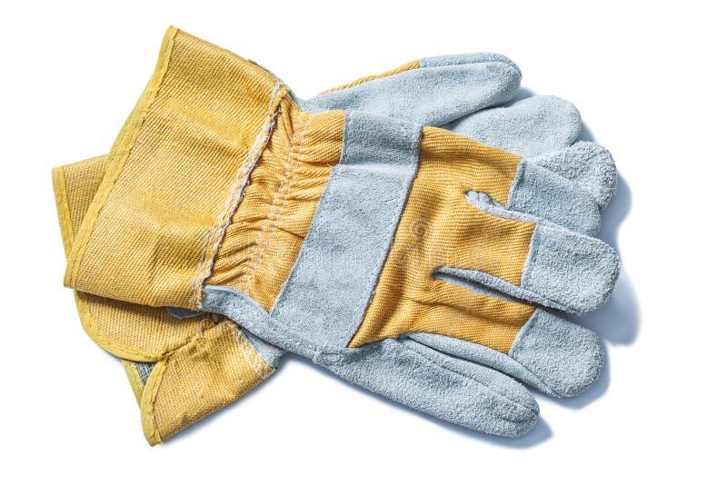 Konstruktionssäkerhet piskar handskar som isoleras på vit royaltyfri bild