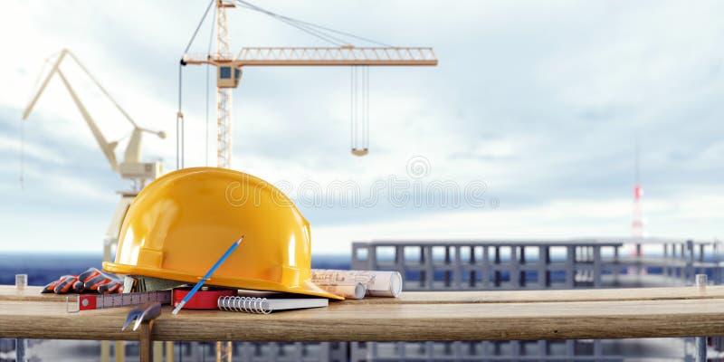 Konstruktionssäkerhetsutrustning med kranar framme av den oavslutade byggnaden arkivfoto