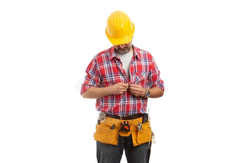 Konstruktor patrzeje jako zapinać koszula zdjęcie stock