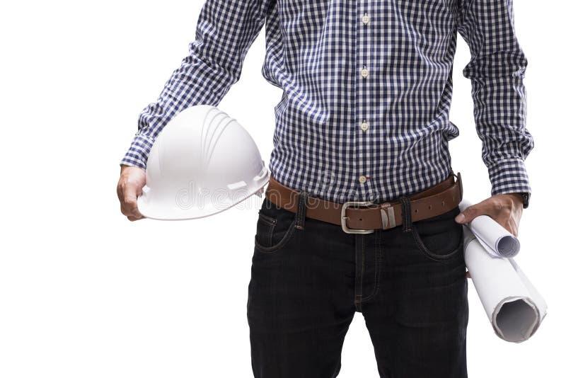Konstruktora mężczyzna trzyma białego projekt i hełm zdjęcia stock