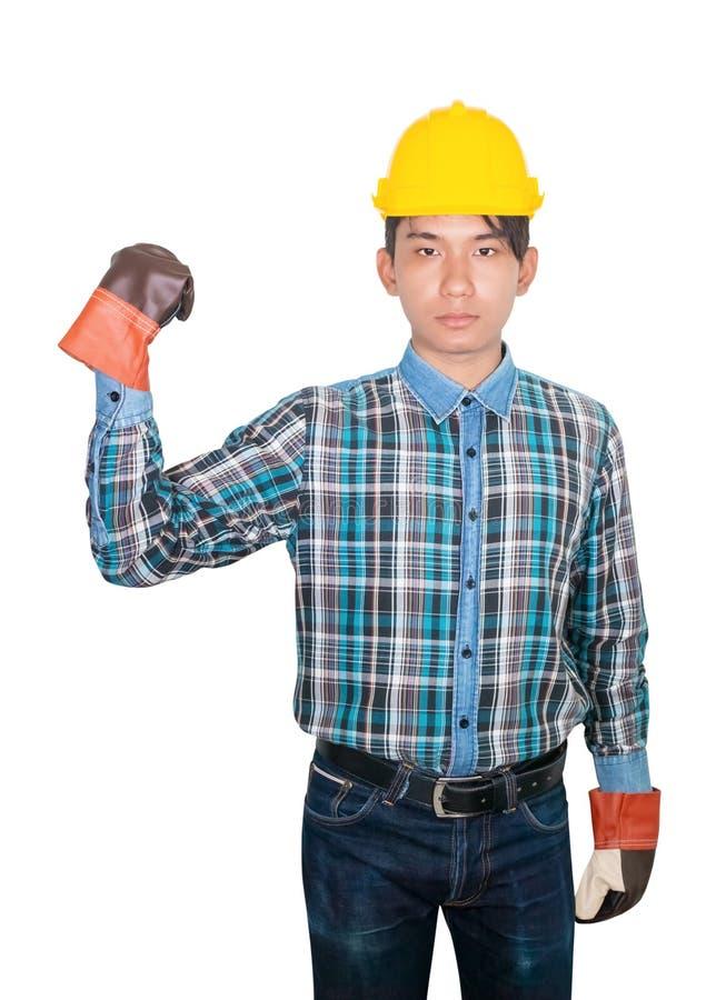 Konstruujący ręki pięści symbol jest ubranym koszulową błękitną i rękawiczkową skórę z żółtym zbawczego hełma klingerytem na kier obrazy royalty free