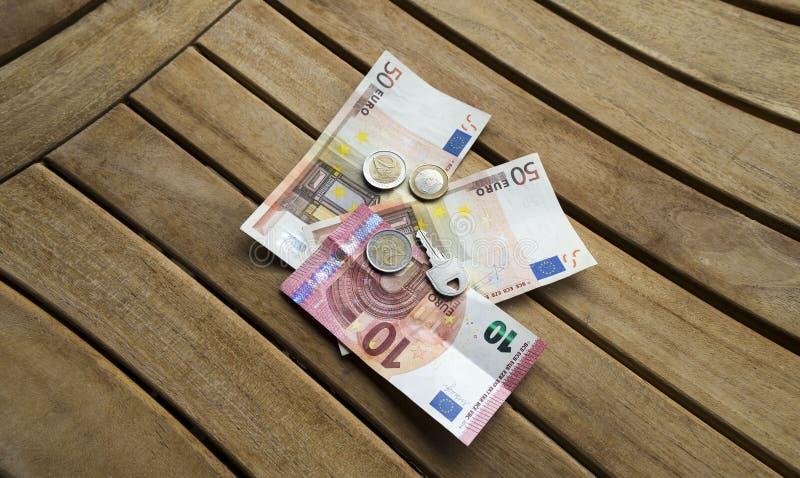 Kontant euro och tangent royaltyfria foton