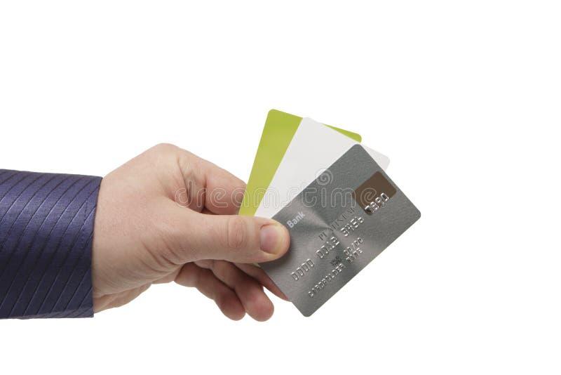 Kontokort i en mans hand - nära övre royaltyfri fotografi