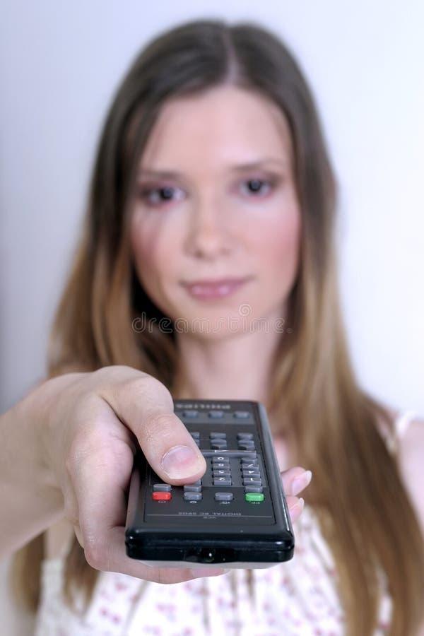 kontrollera fjärrkvinnan royaltyfri foto