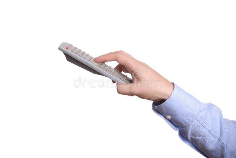 kontrollera handen som rymmer fjärrtv:n royaltyfri foto