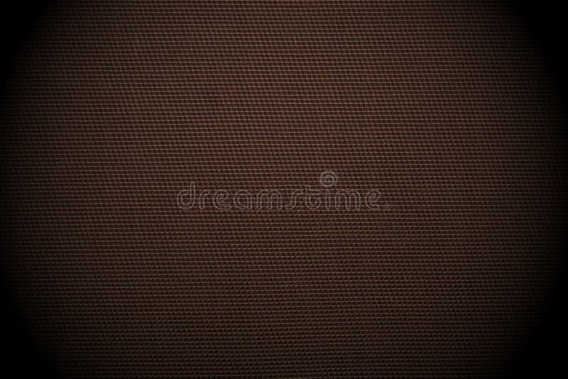 Kontrollerad tygbakgrund för mörk brunt arkivbild