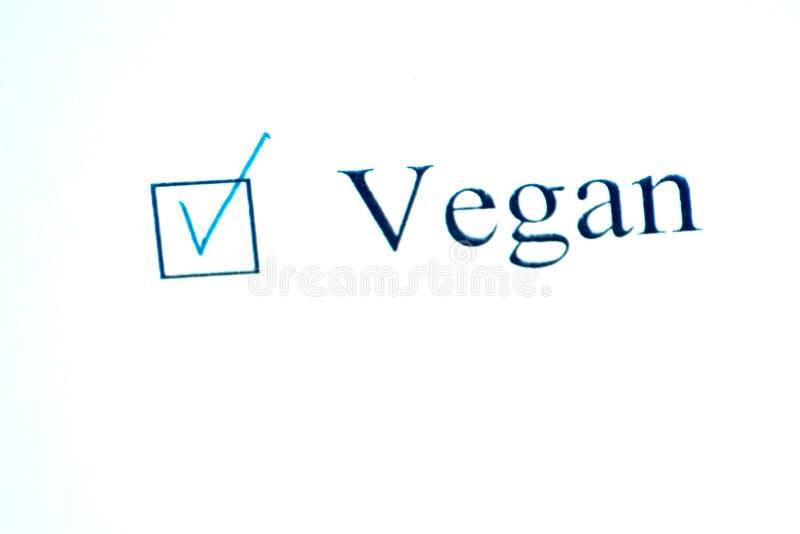 Kontrollista med en ordstrikt vegetarian på vitbok Checkboxbegrepp royaltyfri bild