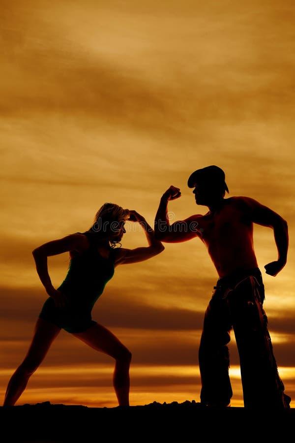Kontur av cowboyen och kvinnan med muskler royaltyfri fotografi