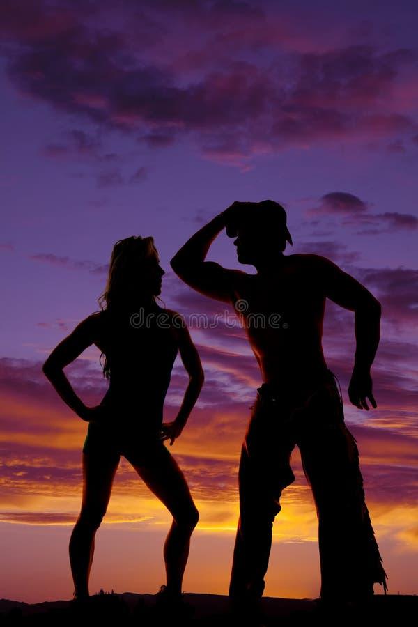 Kontur av cowboyparanseendet i solnedgången arkivfoto