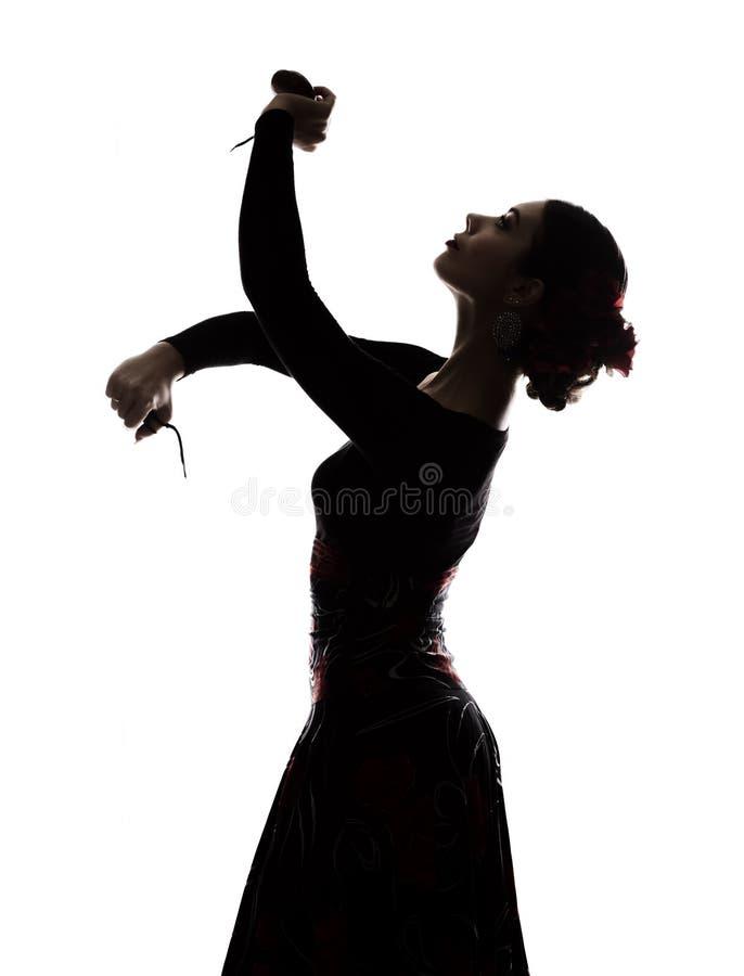 Kontur av den spanska flickaflamencodansaren på en ljus bakgrund royaltyfria bilder
