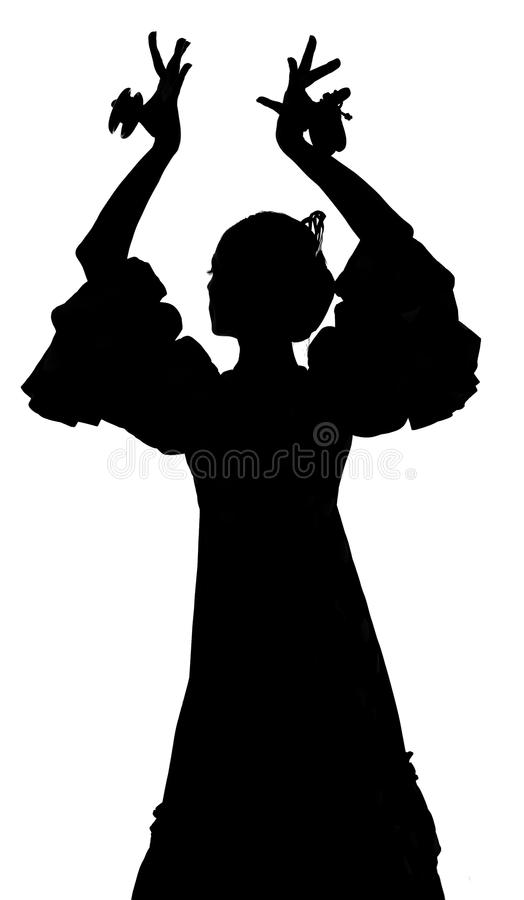 Kontur av den spanska kvinnaflamencodansaren som dansar Sevillanas royaltyfria foton